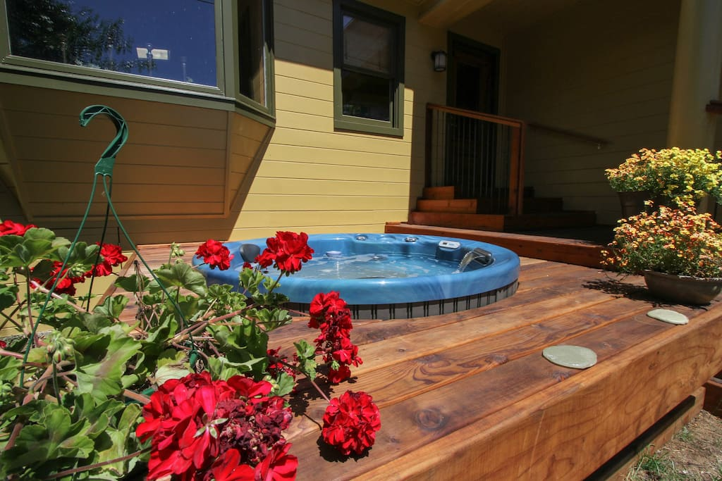 Take a long soak in the sunny, private hot tub at Greentree Cottage!