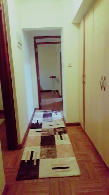 The corridor which connects the two  bedrooms and the living room