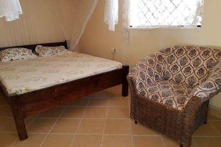 Deluxe room , sleeps two,has a tv and wifi ,self use bathroom