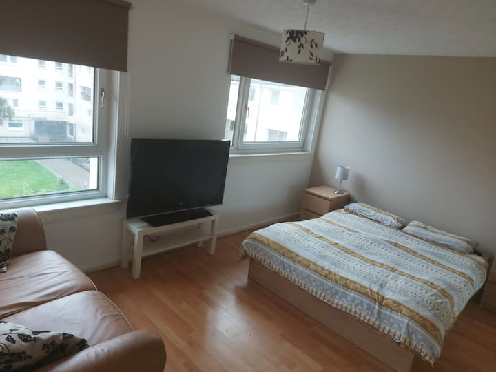 "Double room with sofa, tv 43"" and a big wardrobe."