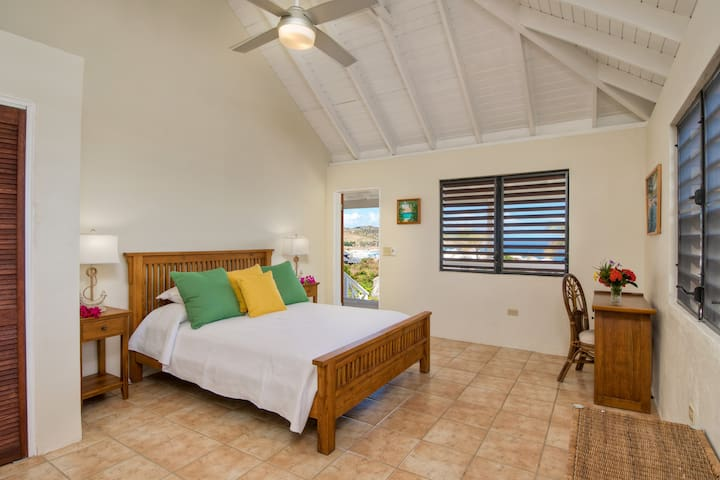 The second guest room has a queen bed and overlooks the pool.