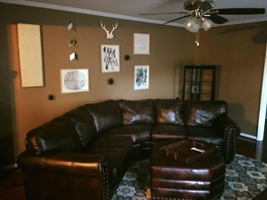 """Living room with mounted 60"""" TV"""