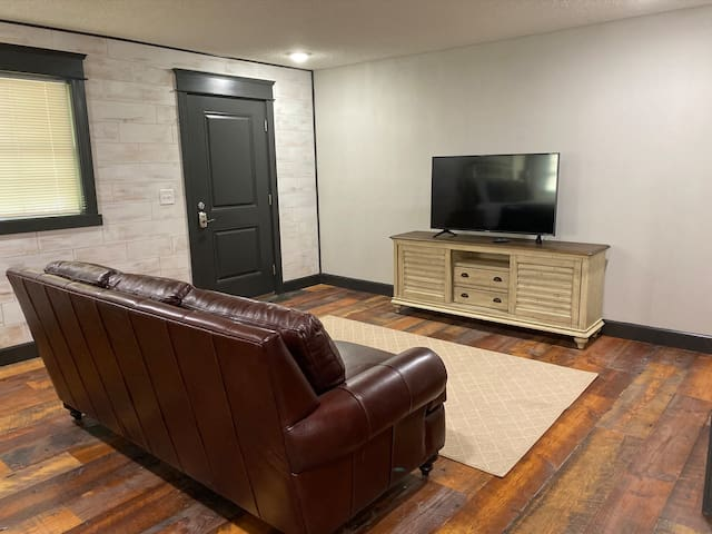 Top grain leather sofa along with a Roku TV.