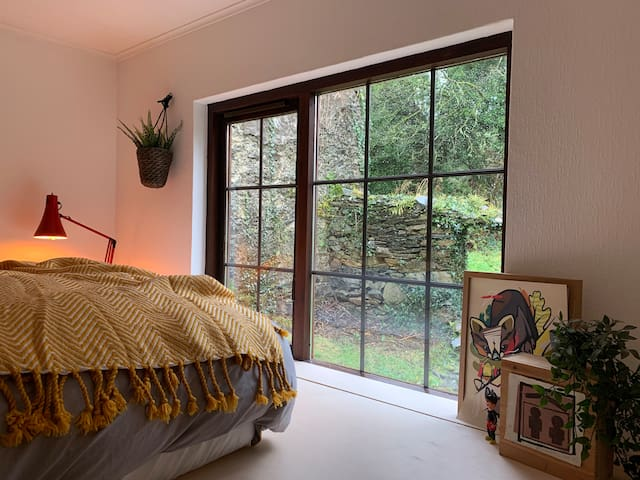 The second bedroom has a king-size mattress, raised floors with direct views of our 18th Century Irish ruins and an under-floor relaxation space with comfy cushions and ambient lighting.