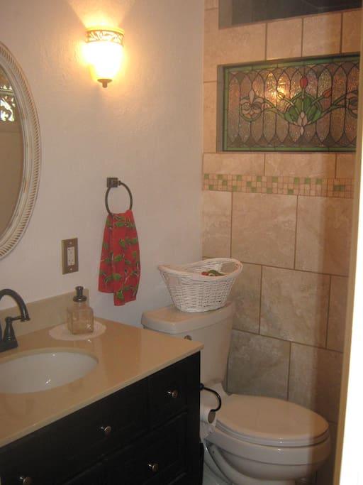 Full bathroom with custom shower