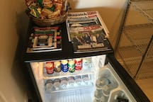 Stocked refrigerator w/water, sodas, chips, candy, crackers and more
