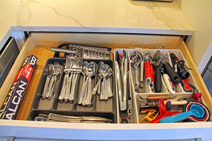 Silverware, cheese graters, foil, and all the kitchen gadgets you can think of to help you enjoy your stay.