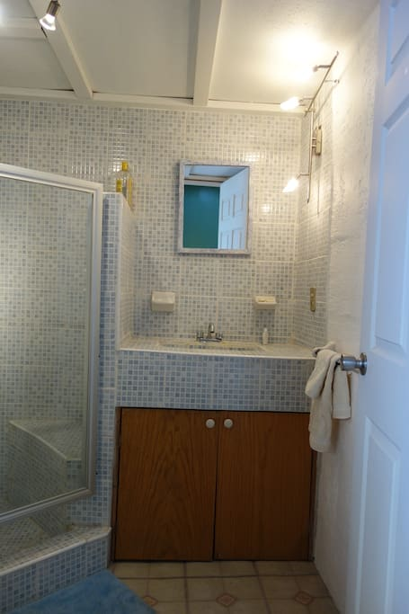 Beautifully remodeled tile bathroom with hot water
