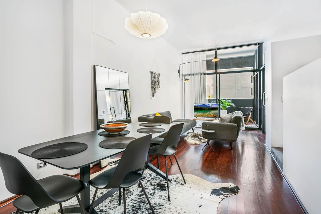 Open dining/lounge with high ceilings