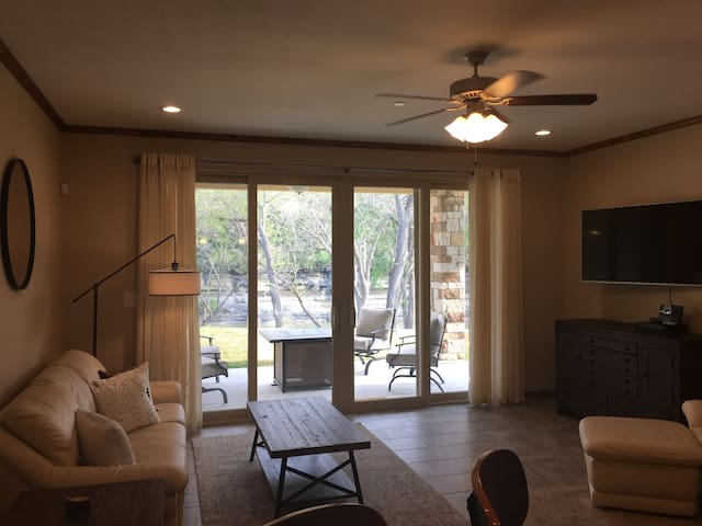 With enough space to comfortably accommodate a party of eight, the living area and walk out patio give you an awesome view of the Guadalupe River right outside of the door.