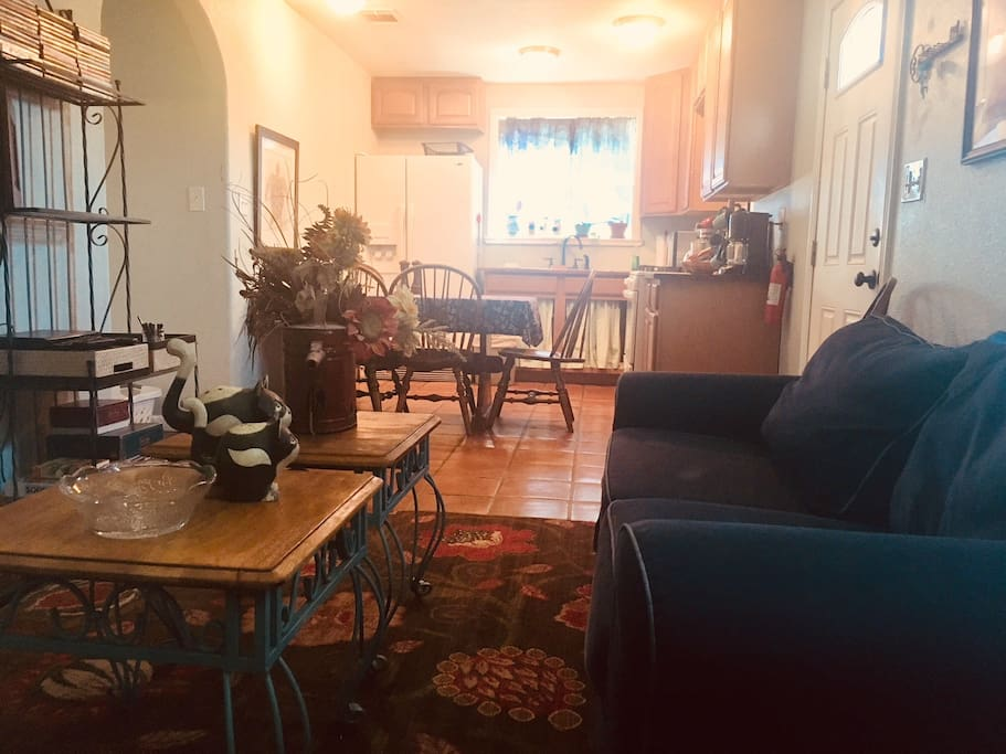 Small living room opens to kitchen
