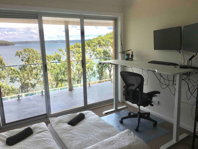 Bedroom 5 - Set up as an office with adjustable standing desk that can have two single floor mattresses and access to balcony with panoramic views