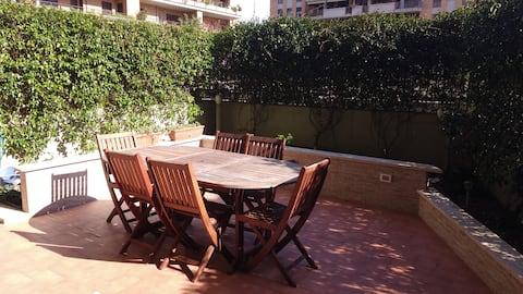 appartamento fiumicino con terrazzo e giardino