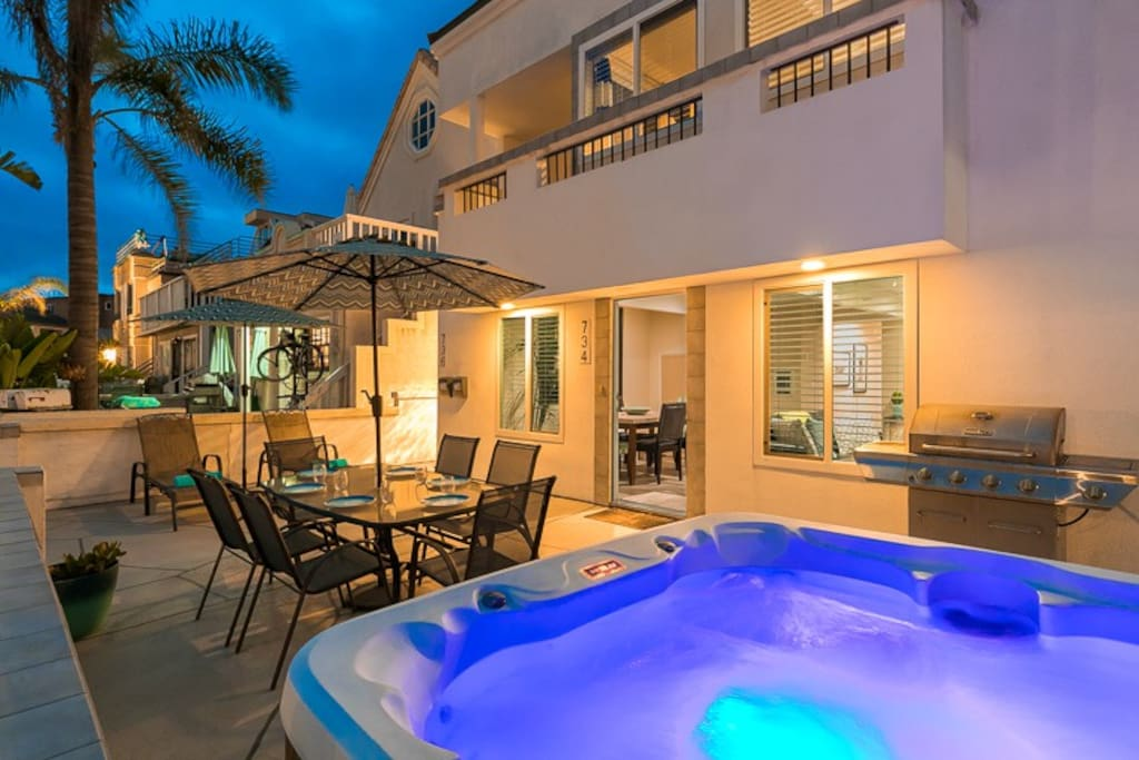 A beautiful patio for dining al fresco, relaxing in the hot tub and/or lounging anytime.