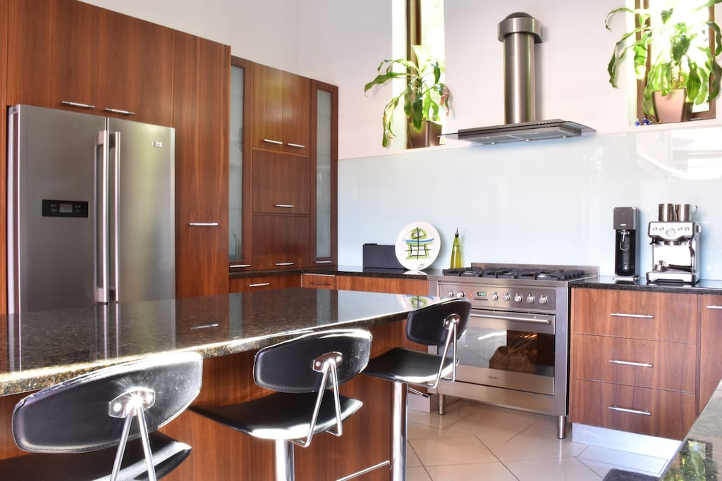 Large kitchen with quality appliances & amenities.