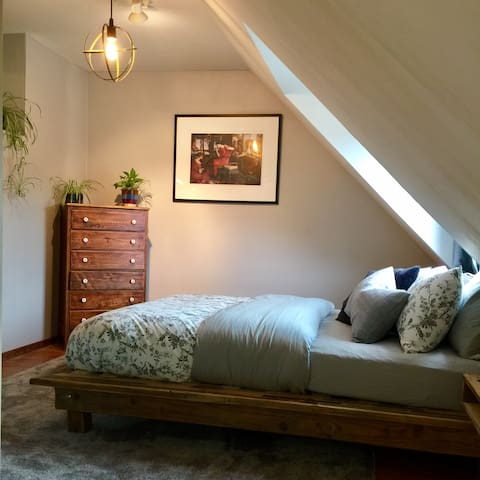 Cozy sleeping area #1 with queen size bed. All natural premium  mattress.