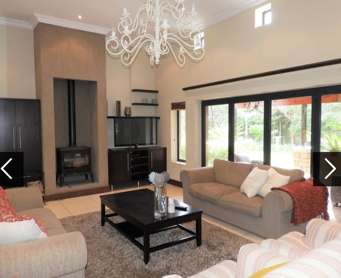 Lounge with log burner, stack away doors to beautiful private garden.