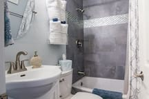 Newly remodeled Master bathroom with full size bathtub. Plush towels, hairdryer, shampoo, conditioner, body soap and extra amenities provided.