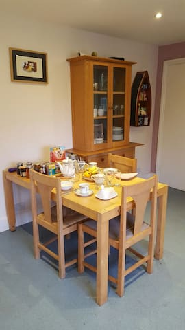 Breakfast in the kitchen or for larger parties in the dining room.