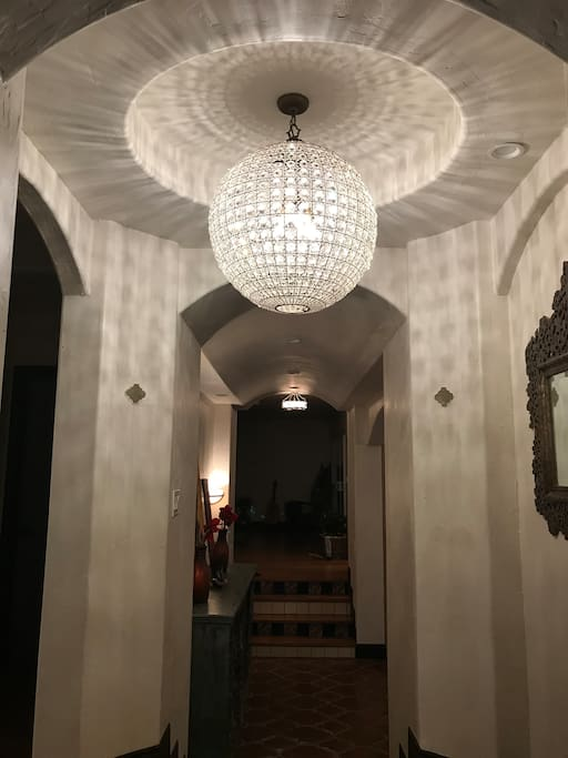 Grand entrance with custom globe chandelier. (Evening)
