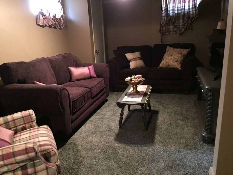 Large private family room with television and plenty of seating.