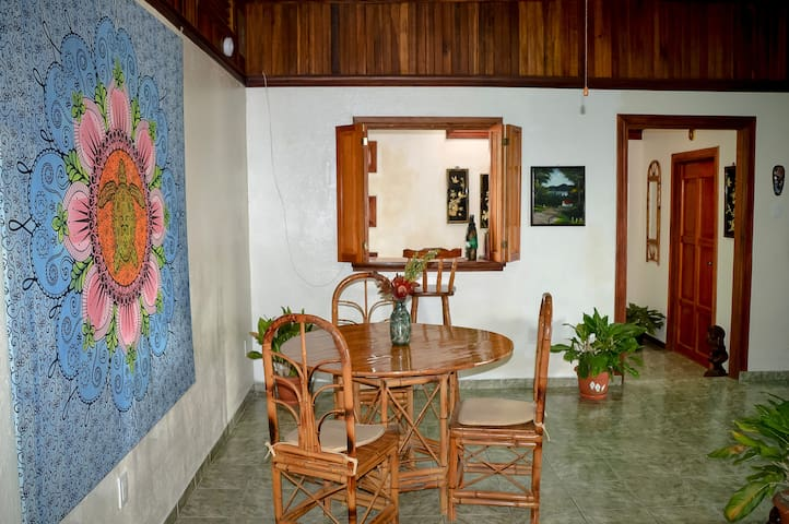 Locally made furniture, agriculturally grown hardwoods and plants throughout.
