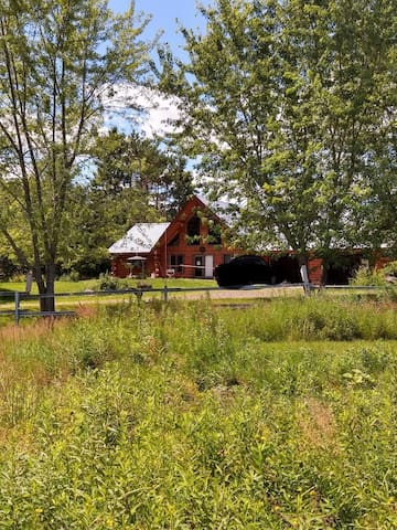 Log Lodge Secluded acres with private lake & pond