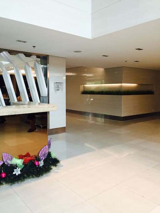 Tower 2 lobby, 24/7 security, receptionist  9.00-18.00. Guests can call the lobby from the unit for taxis, bellhop trolley.