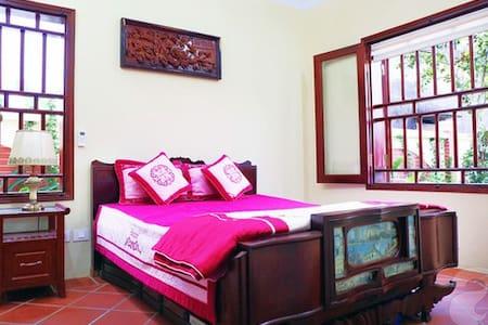Nam Dinh Room views  house and tree - Casa