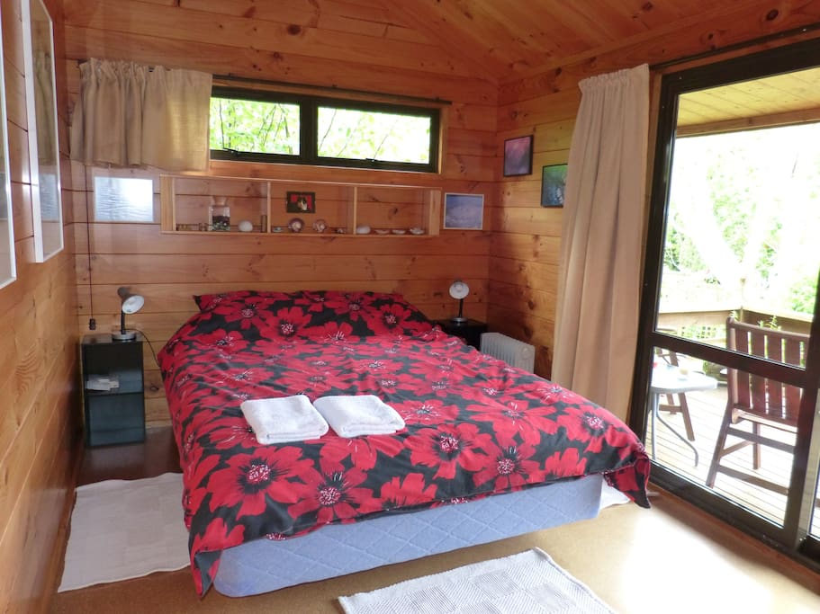 Queen bedroom with sliding door access to private deck with seating. Bedding & towels provided.
