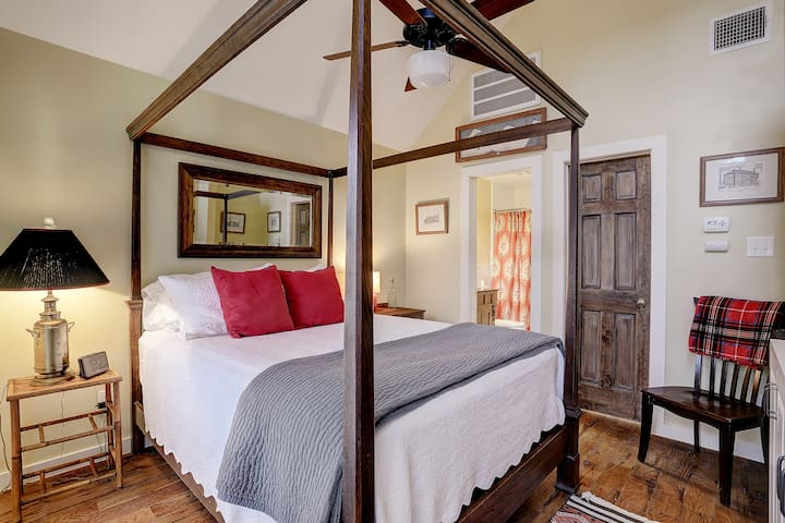 The carriage house is furnished with a lively mix of contemporary and antique furniture. The closed door leads to the large walk-in closet (see next photo).