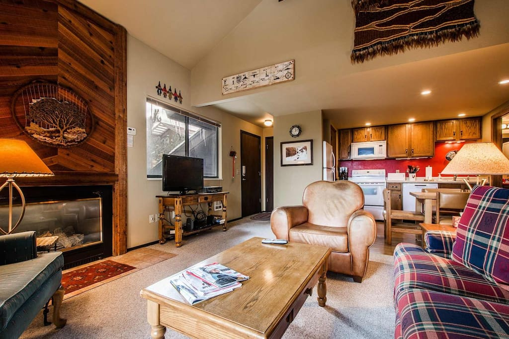 Living room features a HDTV, fireplace and private balcony with BBQ grill.