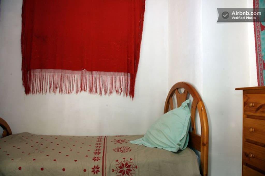 Single bed in triple room