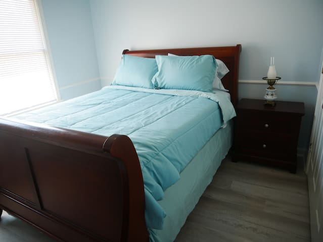 Enjoy your comfortable and cozy Queen Bed! In your room you have a closet with hangers, a laundry basket, a luggage rack, a dresser/nightstand and a TV with a Google Chromecast. If you get warm, you can use overhead fan.