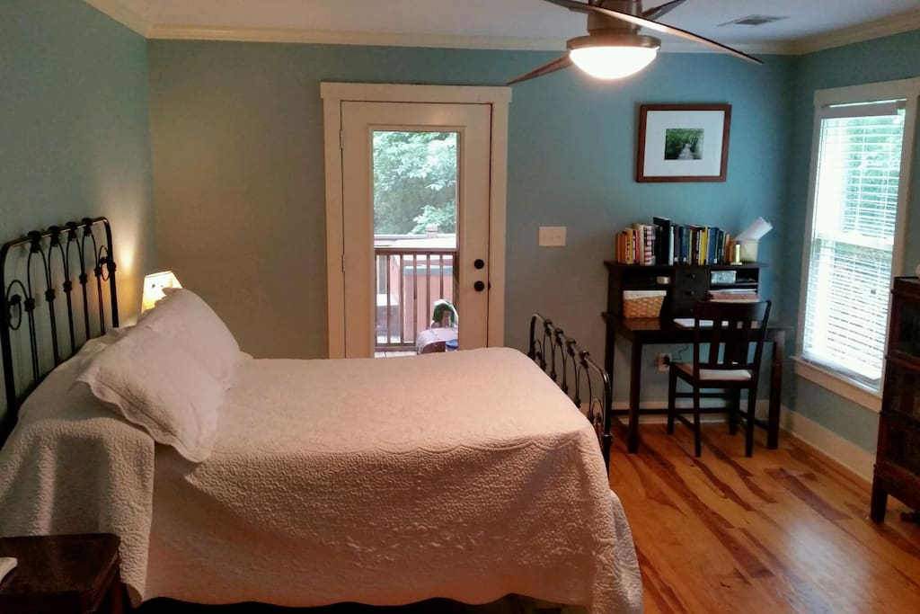 The master bedroom has a full with a pillow-top mattress and entrance to the back porch and hot tub!