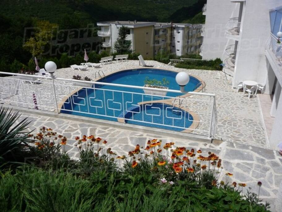 Swimming pool surrounded by flower gardens