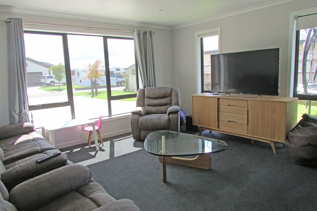Second lounge with Netflix and doors that close off the main open plan living space
