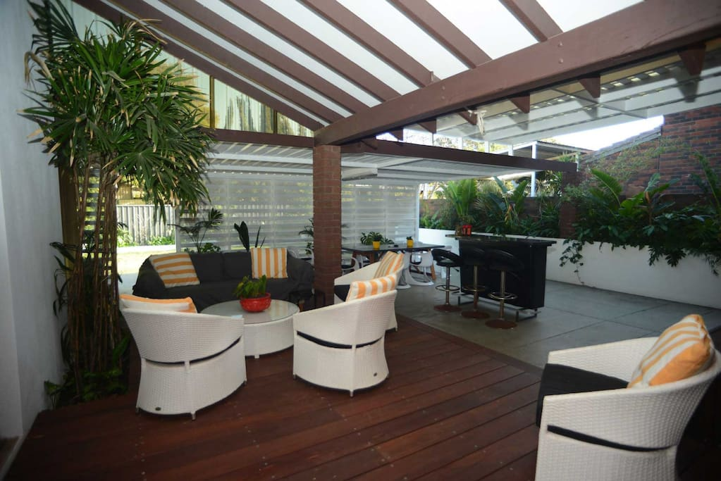 Outdoor lounge and bar areas with beautiful tropical gardens.