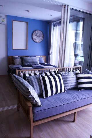 Living room and the 2nd bedroom (glass door)