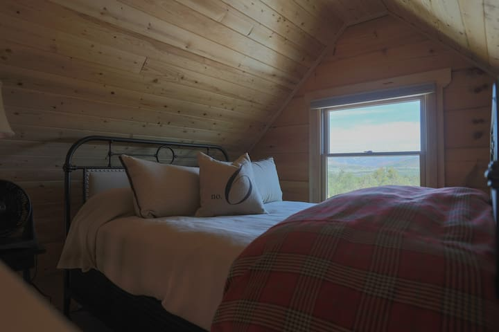 Queen size bed in the loft