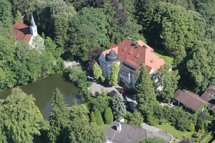 Air view on Castle Moerlbach with a 500 year old chapel to the left