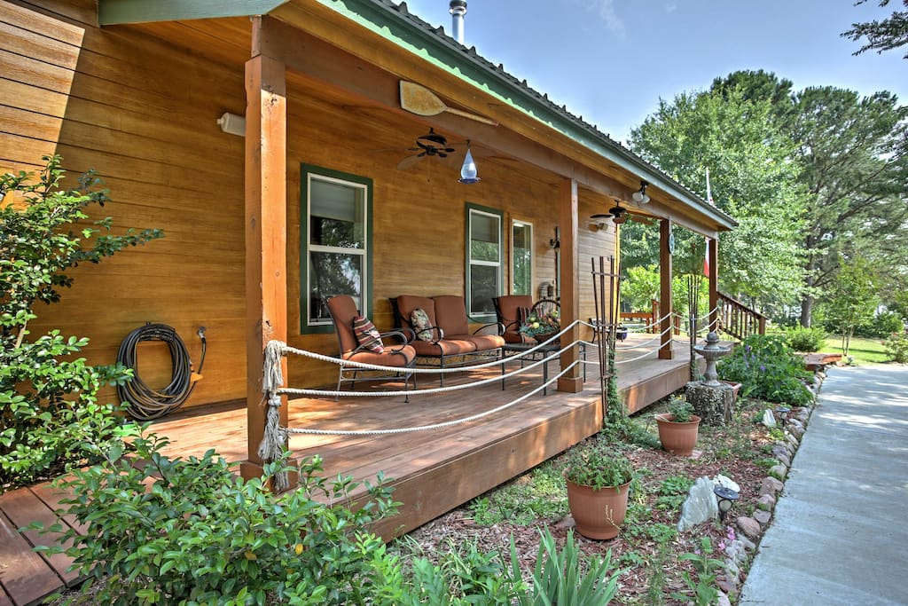 Relax and recharge on this lovely front porch overlooking the lake.