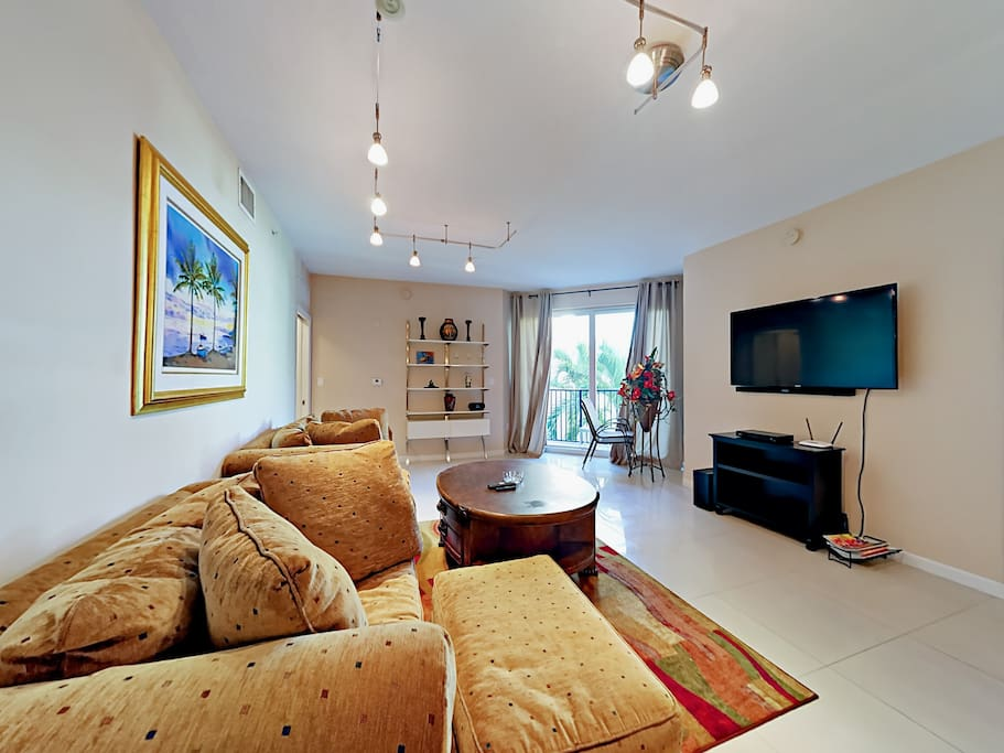 Gleaming white porcelain tile floors and stylish furnishings accent the home's elegant modern style.