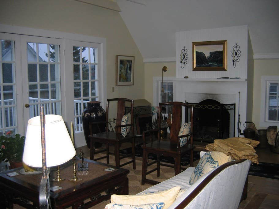 Great room with cathedral ceilings opening to sunny deck on 2nd floor over looking the harbor
