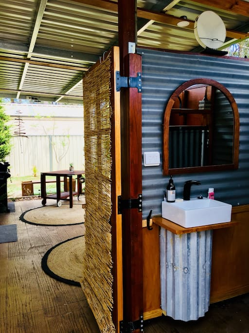 The cute outdoor cubicle styled toilet and shower