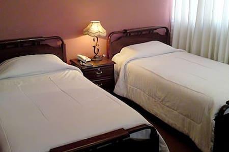 Habitaciones confortables para tres