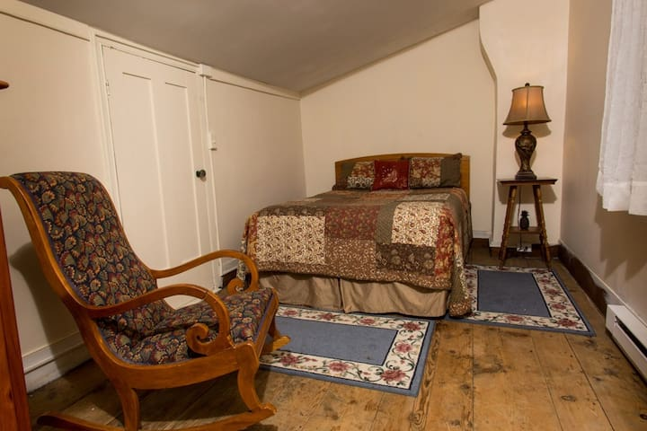 This is Room #4 which  is on the second floor, has a full size bed, and shares a bathroom.