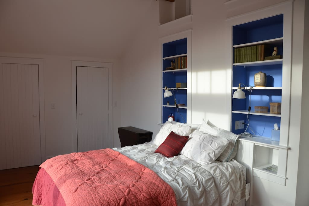 The built-in bookcases in the master bedroom