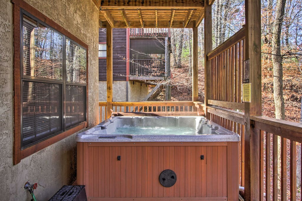 With expansive decks and a private hot tub, this home has everything you'll need to enjoy the fresh air.