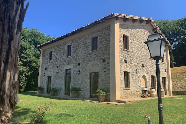 Completely renovated former farmhouse with infinity pool